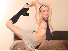 A blonde hottie shows her flexibility off before her man lobs his lad out and fucks her