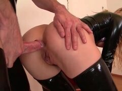 Slut in tight latex fucked in the butt