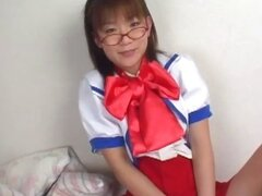 Little Asian schoolgirl is posing and getting ready to rub her slit