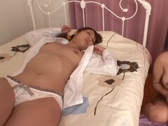 Adorable Japanese girl masturbates in a bedroom while the other is sleeping