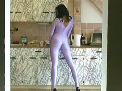 Beauty brunette undressing spandex