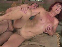 Insatiable Mature Red-Haired Cowgirl Riding a Horny Stud