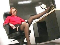Secretary modeling her gorgeous milf stockings