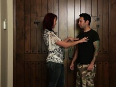 Attractive redhead cougar finds it hard to resist a young guy with a big shaft