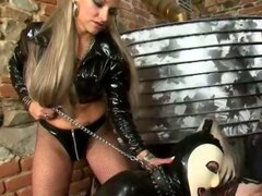 Lezdom subject sucks and spanks femdom cock as she is commanded