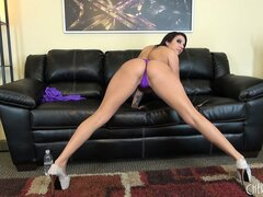 Lylith Lavey rocks a sexy pair of high heels and sucks on a toy