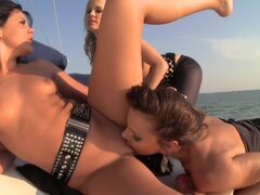 Three horny bitches have lesbian threesome on a boat