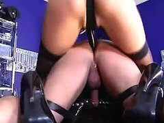 Blonde in latex strapon fucks his ass