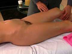 Seductive MILF Holly Michaels gets her oiled up body massaged