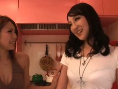 Horny Sakura Kiryu and a friend take control and share a rigid cock in the living room together