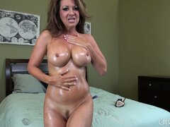 Raquel Devine rubs her oily chest and takes herself to pound town