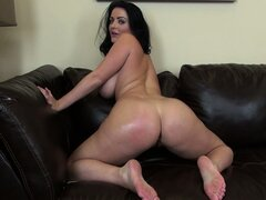 Voluptuous brunette Sophie Dee shows her ass and toys her cunt