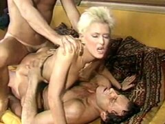 There's always some frantic fun going on when two guys and one gal get together for a double penetration party! Joey Silvera and John Leslie get down and dirty with a brazen blonde bimno, while Herschel Savage and Gabriel Pontello open up an auburn haired honey to more outrageous anal action! Sizzling Sheri St. Claire is in a leather mood, as she commands Ron Jeremy and Billy Dee to do her bidding. There's many more carnal combinations, until the frantic finale-where Eurosex-queen Teresa Orloski takes on a stable of four studs in a piston-pounding anal climax that'll have you panting for more!