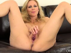 Busty blonde cougar Julia Ann crams that toy deep in her love hole