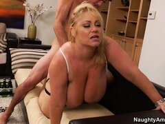 Samantha lies comfortably on the couch while he fucks her snatch nice and deep