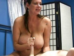 Mature gives him a slow and chatty handjob