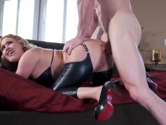 Pretty hot and sexy blonde chick Krissy Lynn in sexy leather bra and stockings bent over on bed at front of Johnny Sins, and he is tightly holding her hips in his strong arms and fucking hard her tiny asshole