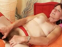 Horny granny jilling off to adult mags