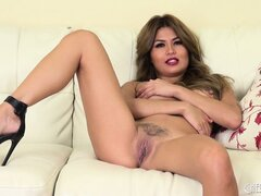 Charmane has her fingers roaming around her cunt and her excitement grows stronger