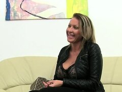 Mature woman havingsex on leather couch