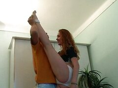 Flexible young redhead