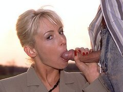 A cock hungry business lady can't help her urges as she gobbles two workers wangs