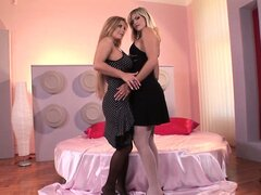 Hot Blondes doing some hardcore footjob positions in bed
