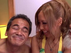 Pretty Japanese girl has MMF threesome with old guys