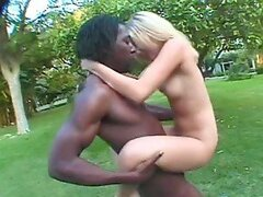 Pretty blonde girl gets fucked rough by Black guy in the park