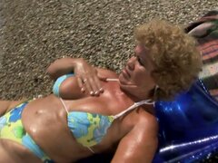 Busty Grandmother Riding A Hard Cock Outdoors at the Beach