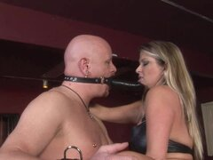 Bald male slave gets banged with strapon