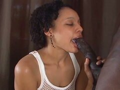 Busty ebony babe sucks on a huge black cock
