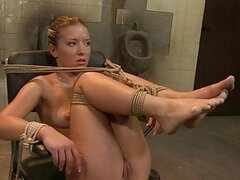 Sexy blonde lesbian dominatrix with great legs gets her slave tied