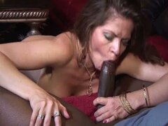 Busty brunette milf takes on a big black cock