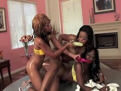 Baby Cakes enjoys having fun with two hot ebony lesbian friends