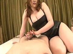 A beautiful, busty Japanese babe massages her man's cock with her hands and feet