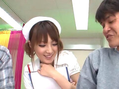 Tsubasa Amami is putting out some hard hand work for her two guys