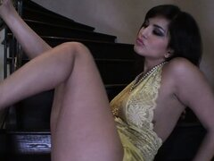 In the staircase, a hot babe with a perfect ass and big tits fingers her sweet pussy