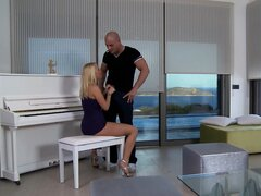 Sexy blonde Carla Cox is doggyfucked on a piano