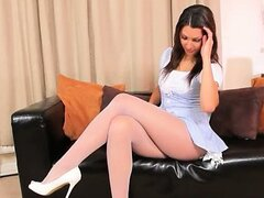 Pink panties and high heels on the sofa