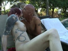 Skinny shemale with tattoos and glasses rides a dick outdoors