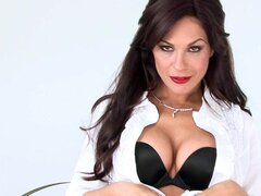 Sexy secretary Kirsten Price with glasses is posing her body in the office