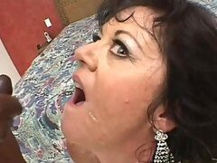 Horny Mature Swallows Cum From Two Big Throbbing Cocks