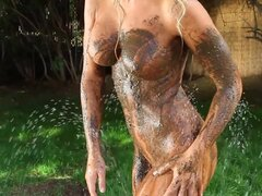 Blonde covered in mud is sexy