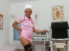 Mature blonde nurse dildos her tight pink cunt
