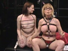 Milf and young chick are having BDSM style sex