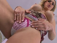 Hot mama Tanya stuffs her pussy with huge beads