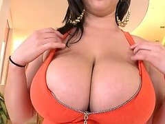 Hot Brunette Makes Her Huge Tits Jiggle As She...