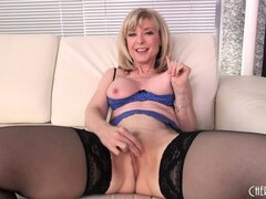 Mature blonde hottie Nina Hartley puts on a hot solo in her sexy stockings