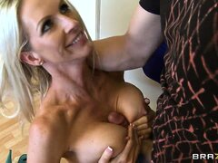 The hot blonde loves stroking that big cock with her lovely huge tits